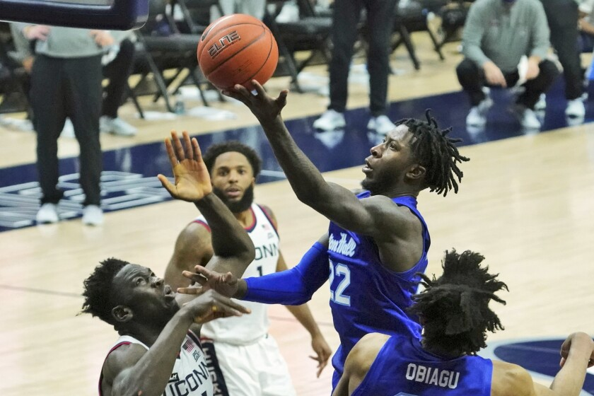 Seton Hall guard Myles Cale (22) drives to the basket against Connecticut during the second half of an NCAA college basketball game, Saturday, Feb. 6, 2021, at Harry A. Gampel Pavilion in Storrs, Conn. (David Butler II/Pool Photo via AP)