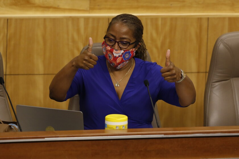State Sen. Holly Mitchell, D-Los Angeles, chair of the Senate budget committee, gives a double thumbs after Sen. Nancy Skinner, D-Berkeley, joins by video in a hearing at the Capitol in Sacramento on Thursday.