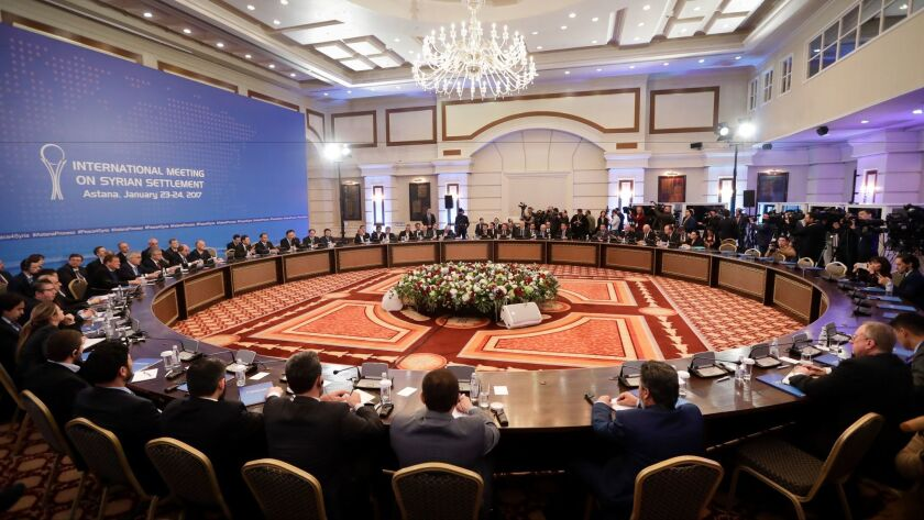 Delegations from Russia, Iran and Turkey hold talks on Syrian peace at a hotel in Astana, Kazakhstan, on Jan. 23, 2017.