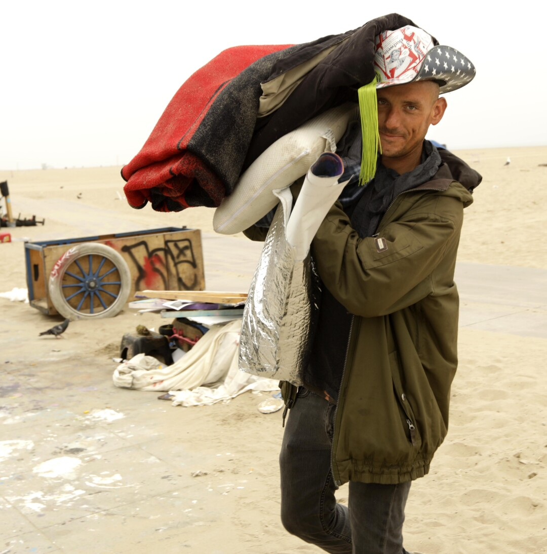 Mike McKenna, 38, helps a friend move his belongings in Venice. McKenna, who has been living homeless on the beach