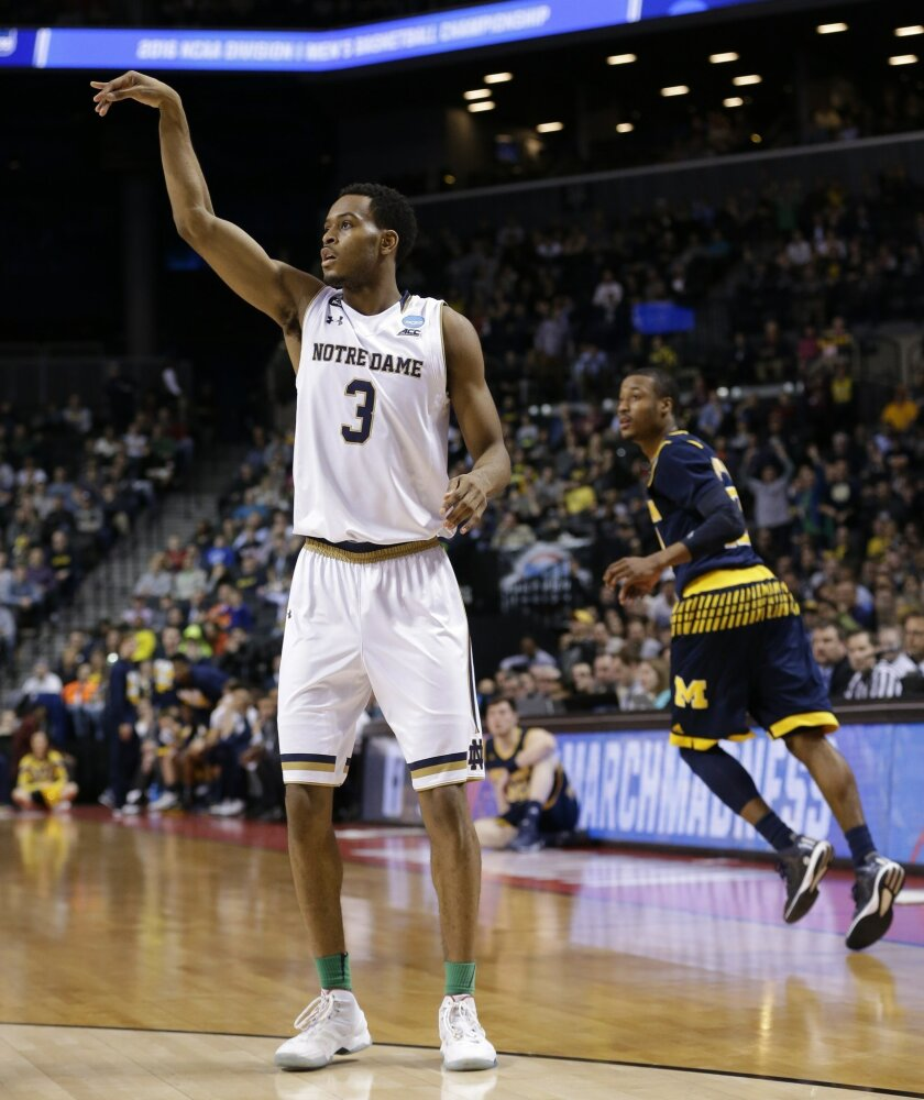 Notre Dame's V.J. Beachem (3) gestures after making a 3-point basket as Michigan's Muhammad-Ali Abdur-Rahkman watches during the second half of a first-round men's college basketball game in the NCAA Tournament, Friday, March 18, 2016, in New York. Notre Dame won 70-63. (AP Photo/Frank Franklin II)