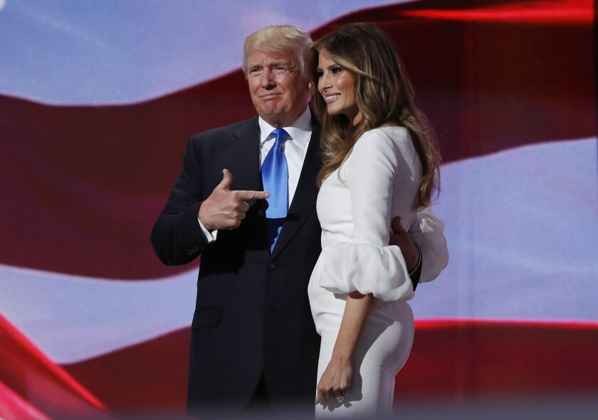 Republican presidential candidate Donald Trump, right, greets his wife Melania after introducing her during the Republican National Convention, Monday, July 18, 2016, in Cleveland. (AP Photo/Carolyn Kaster)