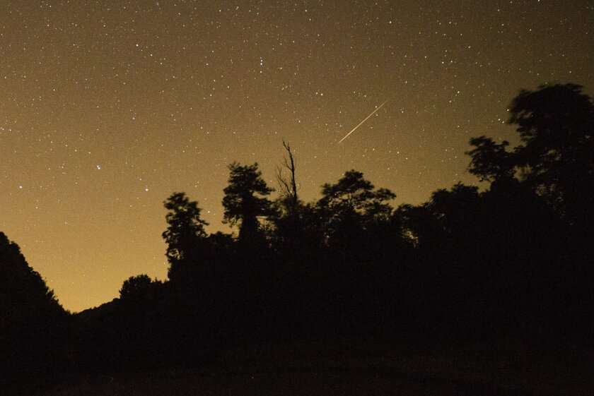 A meteor from the Perseid Meteor Shower is seen above Shenandoah National Park in Virginia.