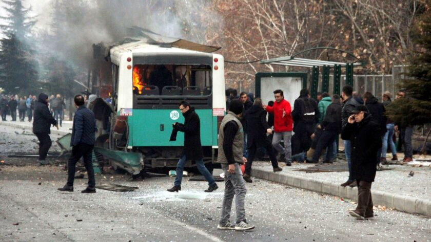 A public bus burns at the scene of a car bomb attack in the central Anatolian city of Kayseri, Turkey.
