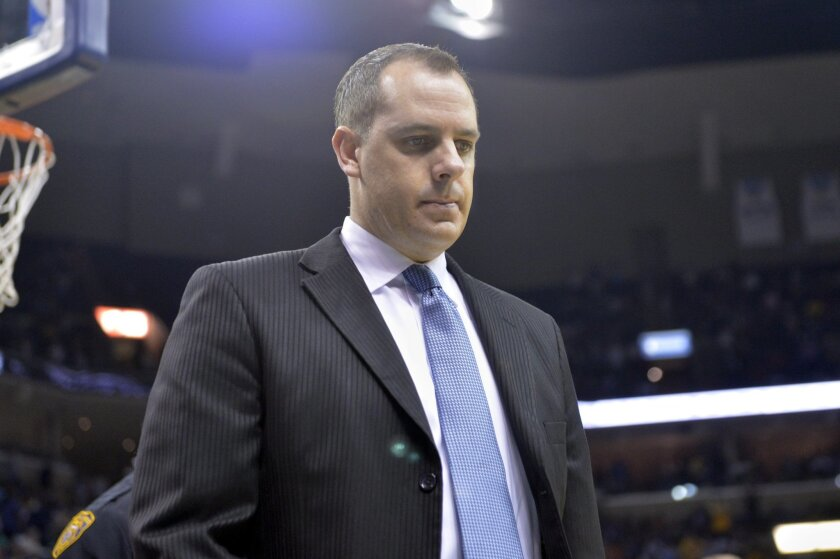 Indiana Pacers head coach Frank Vogel leaves the court after the first half of an NBA basketball game Wednesday, April 15, 2015, in Memphis, Tenn. (AP Photo/Brandon Dill)