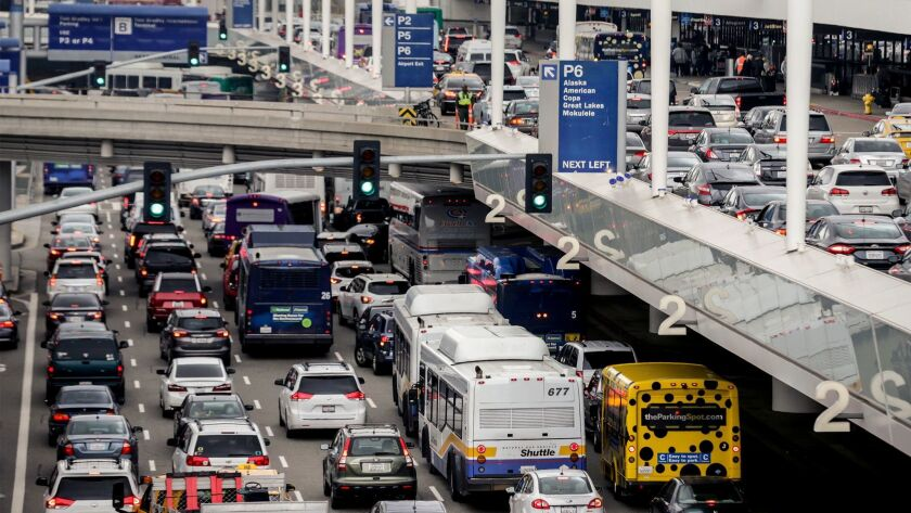 Traffic jams the central terminal area at LAX during the holidays last year. Airport officials hope to reduce the congestion with a $5-billion ground transportation improvement plan that is now being challenged in court.