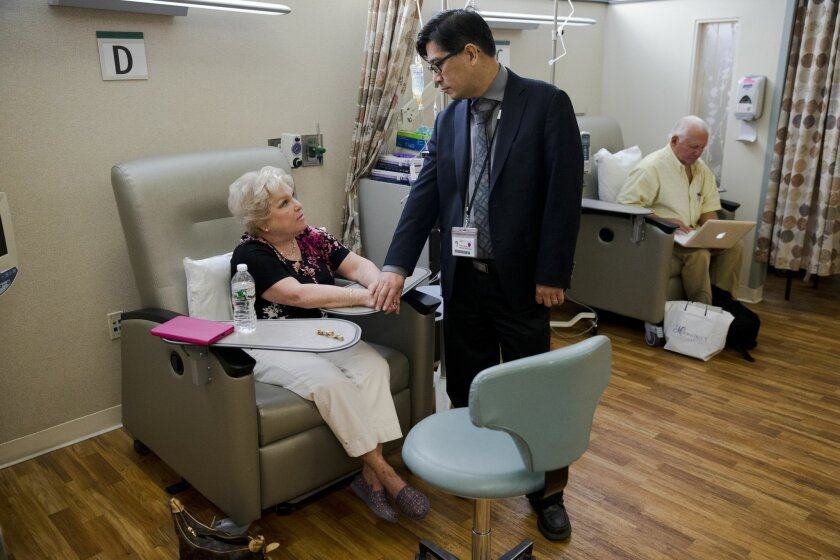 Judith Bernstein meets with Dr. Henry Fung at the Fox Chase Cancer Center in Philadelphia on Tuesday, Aug. 4, 2015. Her husband, Arnold, is at right. Bernstein has had eight different types of cancer over the last two decades, all treated successfully. About 19 percent of cancers in the United States now are second-or-more cases, a recent study found. In the 1970s, it was only 9 percent. (AP Photo/Matt Rourke)