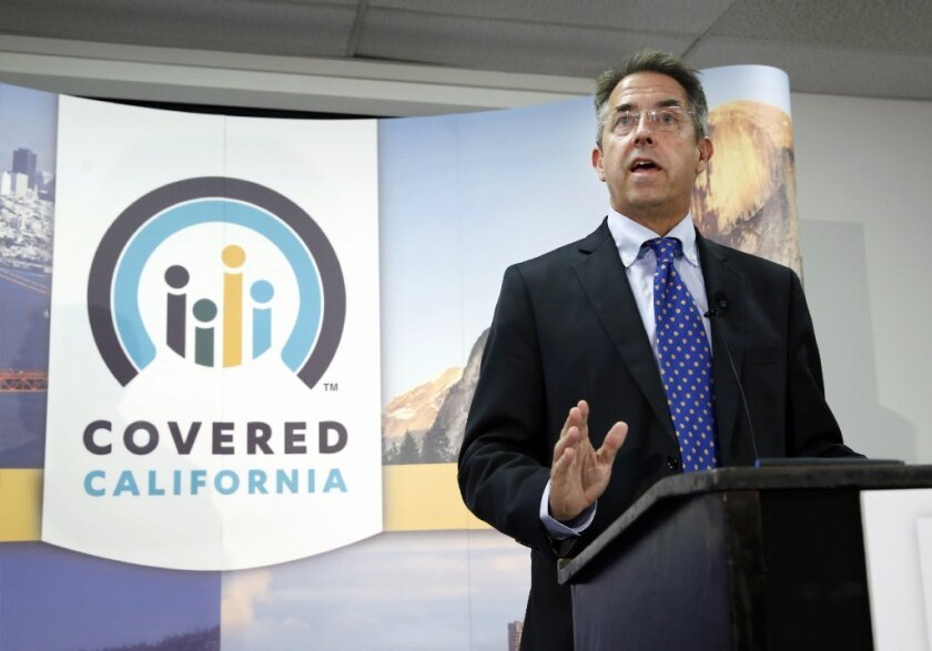 Peter Lee, executive director of Covered California, discusses enrollment in the exchange during a talk in November.