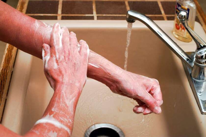 Experts recommend washing with soap for at least 20 seconds to kill germs.