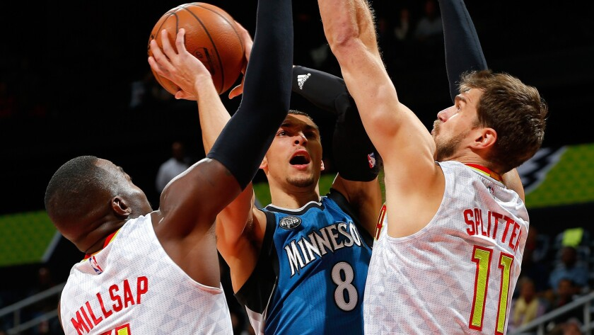 Timberwolves guard Zach LaVine tries to score inside against Hawks forward Paul Millsap and center Tiago Splitter during a game Nov. 9.