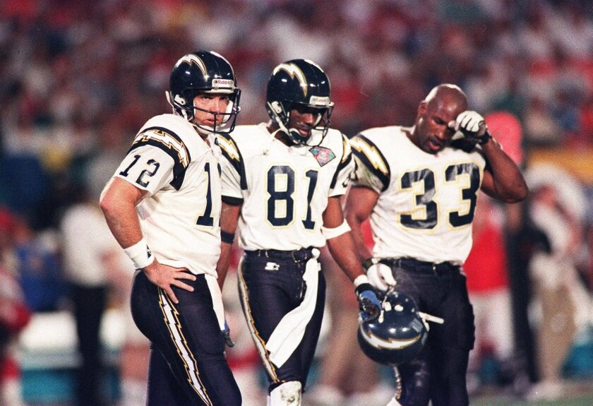 Chargers quarterback Stan Humphries, wide receiver Tony Martin, and running back Ronnie Harmon leave the field after a failed offensive effort in Super Bowl XXIX on Jan. 29, 1995 in Miami. The Chargers lost to the 49ers, 49-26.