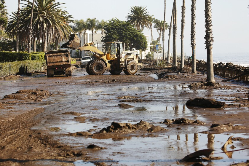 Cleanup begins Thursday morning outside the Four Seasons Biltmore on Channel Drive in Montecito.