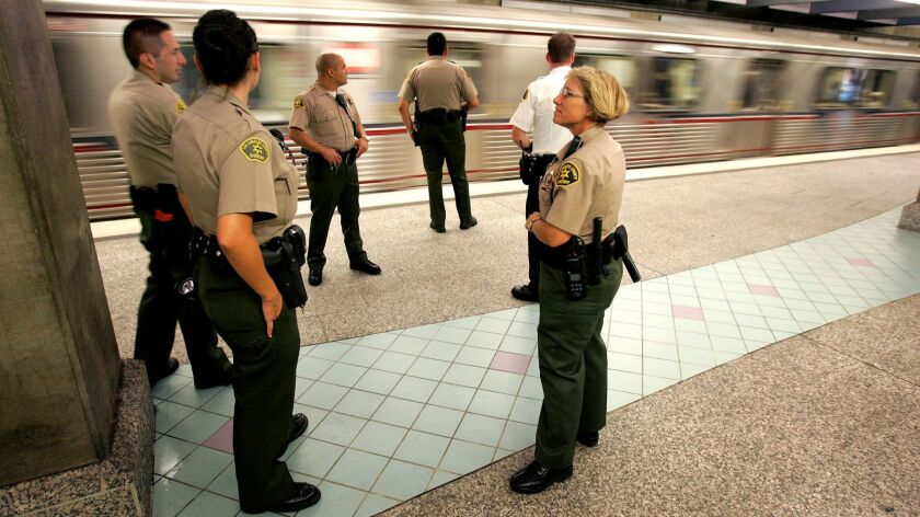 Sheriff's deputies guard the Hollywood/Highland Red Line station platform. A bundle of contracts approved Thursday will shift the bulk of Metro's policing duties from the Sheriff's Department to police departments in Los Angeles and Long Beach.