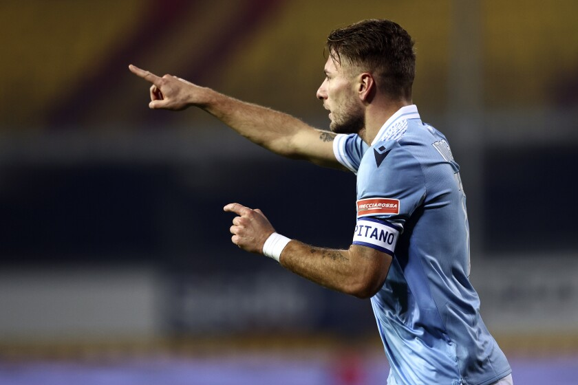 Lazio's Ciro Immobile celebrates after scoring during the Italian Serie A soccer match between Benevento and Lazio, at the Vigorito stadium in Benevento, Italy, Tuesday, Dec. 15, 2020. (Alessandro Garofalo/LaPresse via AP)
