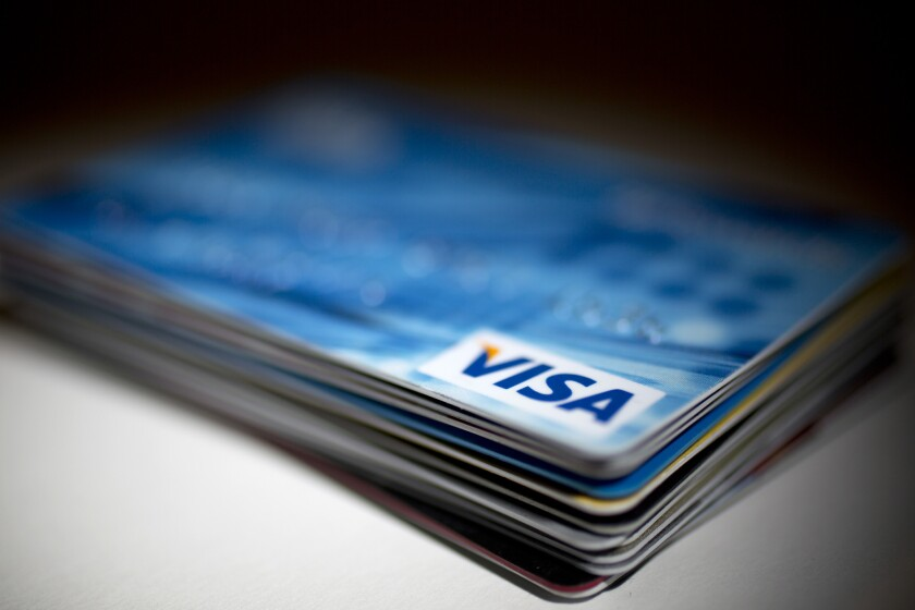 There is about $850 billion in outstanding credit card debt in the U.S., a record dollar amount.