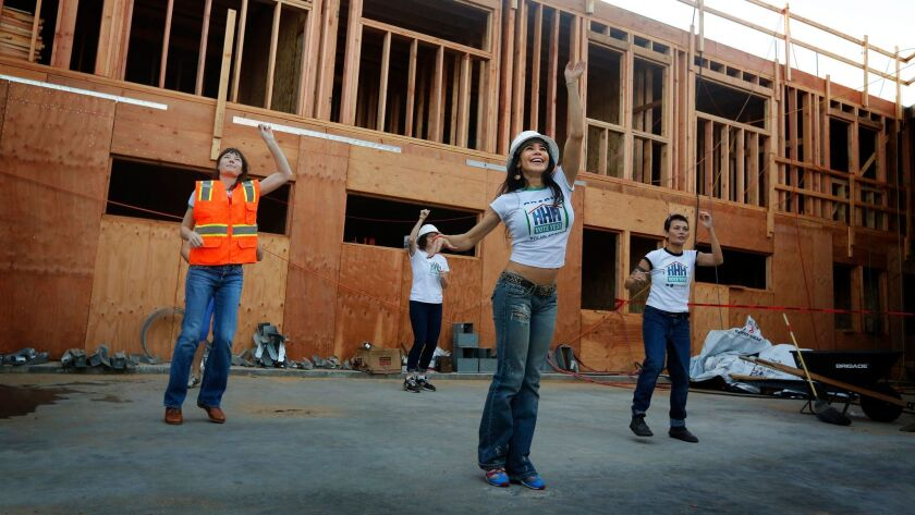 Fransini Giraldo, center, leads performers during a video shoot last week in support of Proposition HHH, the homeless housing construction bond on Tuesday's ballot.