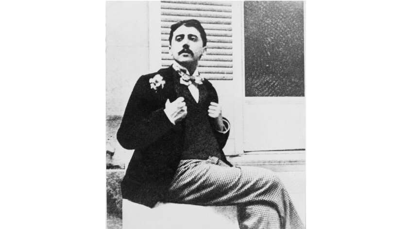 Marcel Proust dons a boutineer and bow tie.