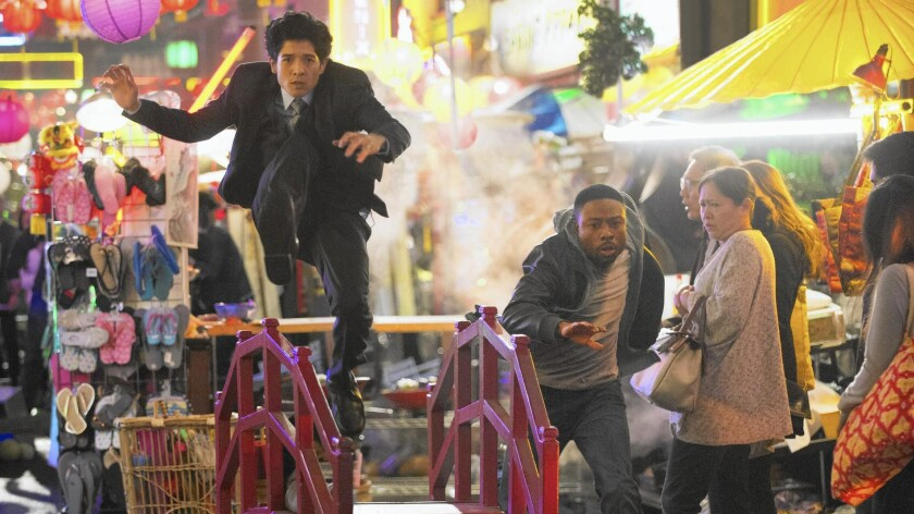 "Jon Foo, left, and Justin Hires, running alongside, star in the new CBS buddy-cop comedy ""Rush Hour."""