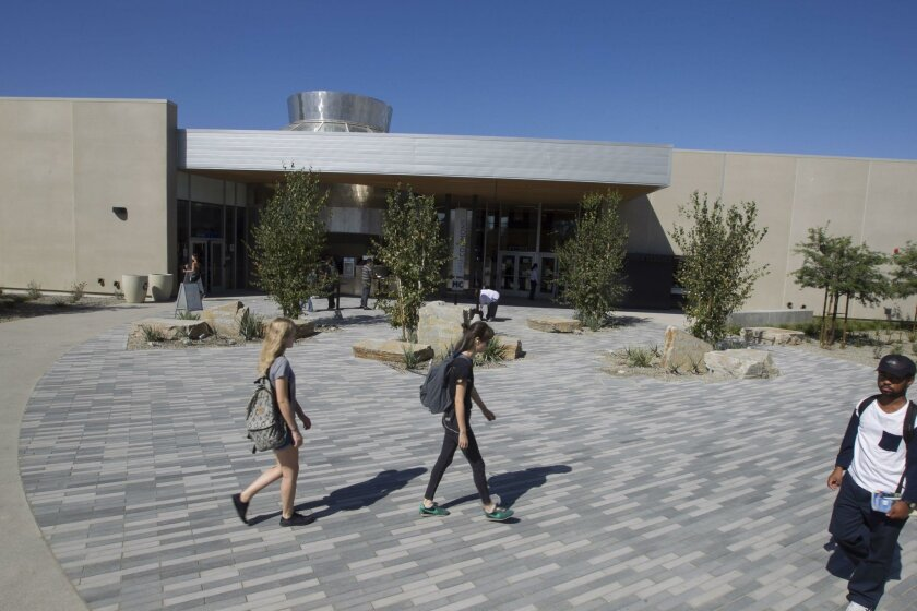 Students walk across new Sunrise Plaza entryway outside Mesa Commons, the new cafeteria and bookstore at Mesa College.