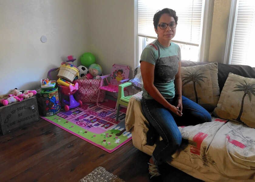 Navy veteran Laura Estrada in the West Adams apartment she found with help from the Downtown Women's Center. Estrada was honorably discharged in 2001, and she's since had to deal with the PTSD caused by the harassment and humiliation she suffered during her four-year tour of duty.