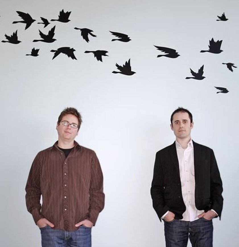 Twitter founders Biz Stone (left) and Evan Williams, in their San Francisco offices, say the company intends to start testing ways to make money this spring. Williams won't say what he has in mind, besides selling ads. (Associated Press)