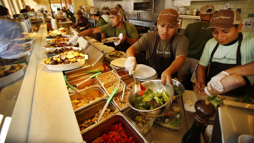 Tender Greens operates 17 locations, all in California. Above, Tender Greens workers prepare lunch for customers in Santa Monica last month.