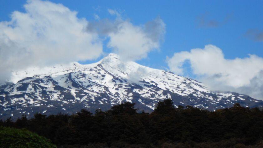 Volcanic Mount Tongariro marks the location of Tongariro National Park, rich in Moari history.