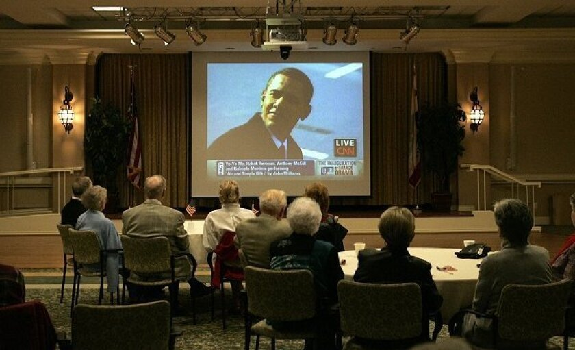 Residents and family members at La Costa Glen Retirement Community gathered at Catalina Hall on their campus to watch the inauguration of Barack Obama, the 44th President of the United States.