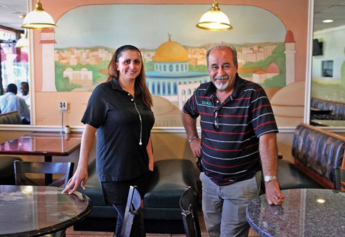 Suzan Hassan is floor manager and Abu Ahmad owner of the 5-year-old Olive Tree Restaurant in Anaheim, which alongside familiar Middle Eastern dishes also serves regional recipes of Jordan, Syria and elsewhere.