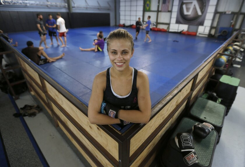 Paige VanZant pauses after a workout at the Ultimate Fitness gym in Sacramento on April 13, 2015.