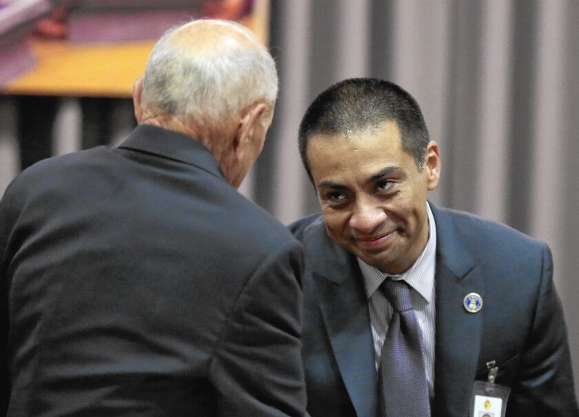 Ref Rodriguez, a new member of the Los Angeles Board of Education, greets Supt. Ramon Cortines before the board's meeting Wednesday.