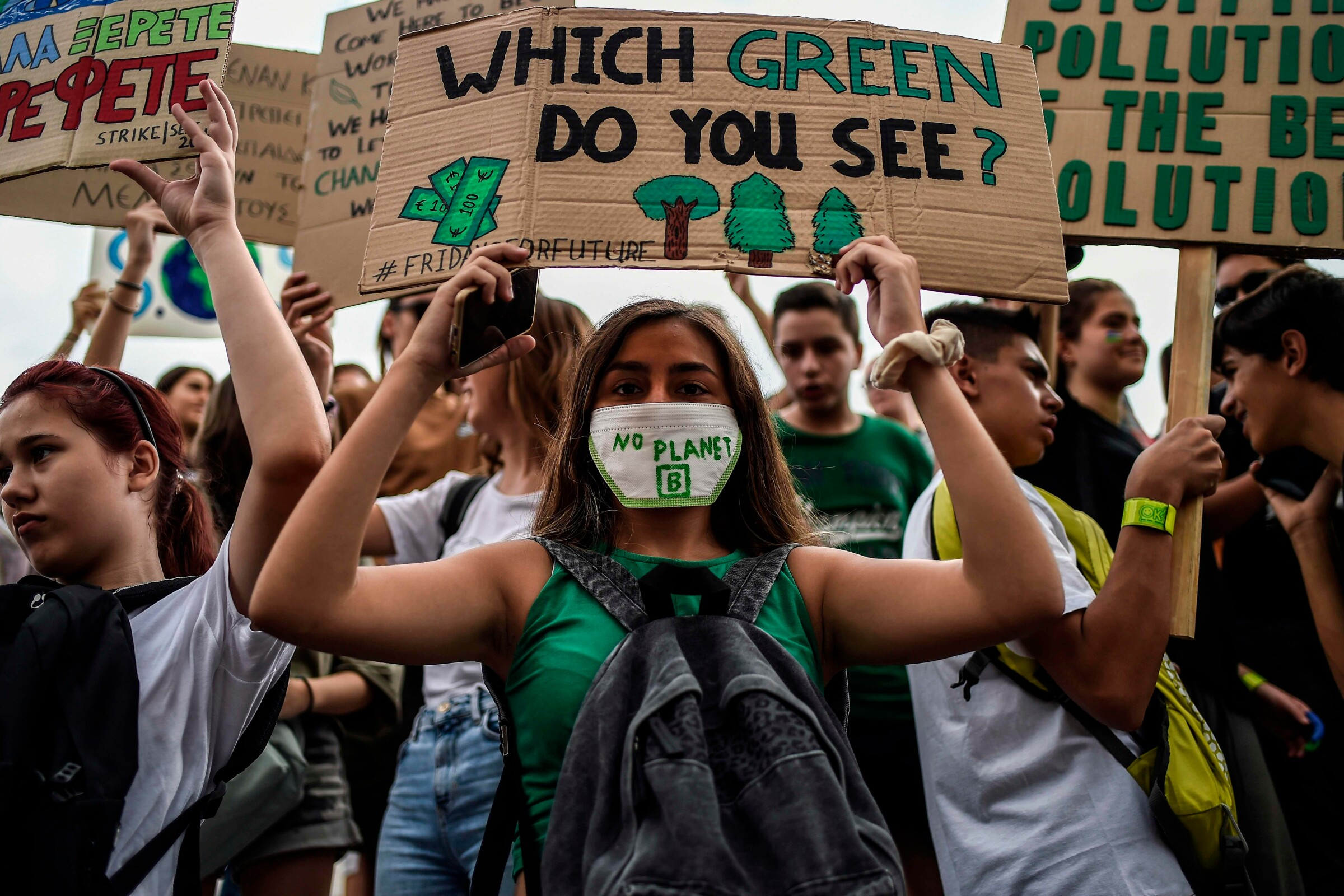 Protesters hold up signs against climate change