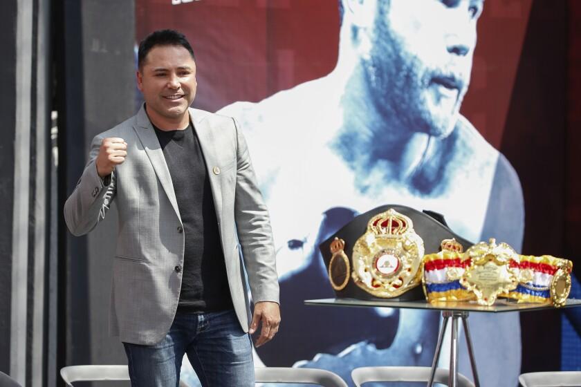 Golden Boy Promotions Inc. founder Oscar De La Hoya pumps his fist during a news conference