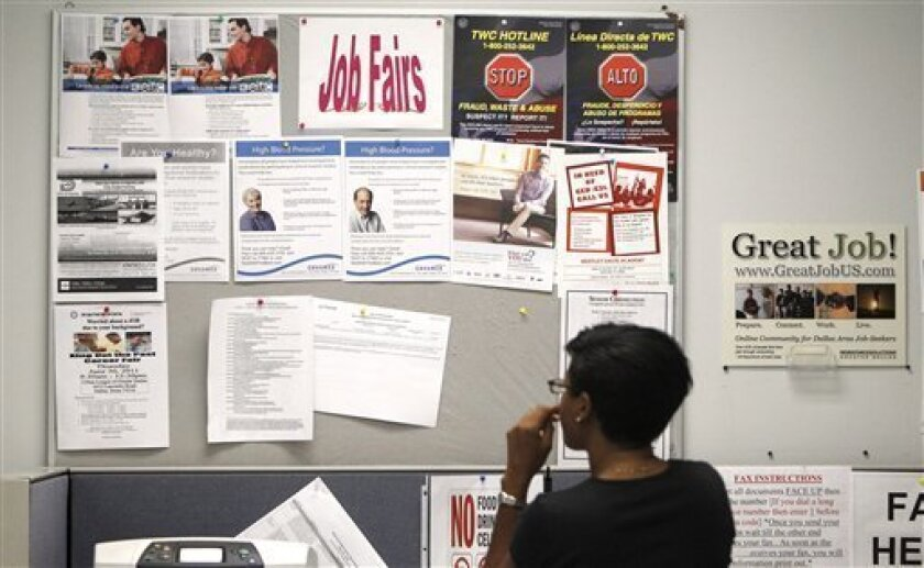 A job seeker looks at a bulletin at the Texas Workforce Commission's Workforce Solutions of Greater Dallas job resource center in Richardson, Texas Tuesday, July 5, 2011. (AP Photo/LM Otero)