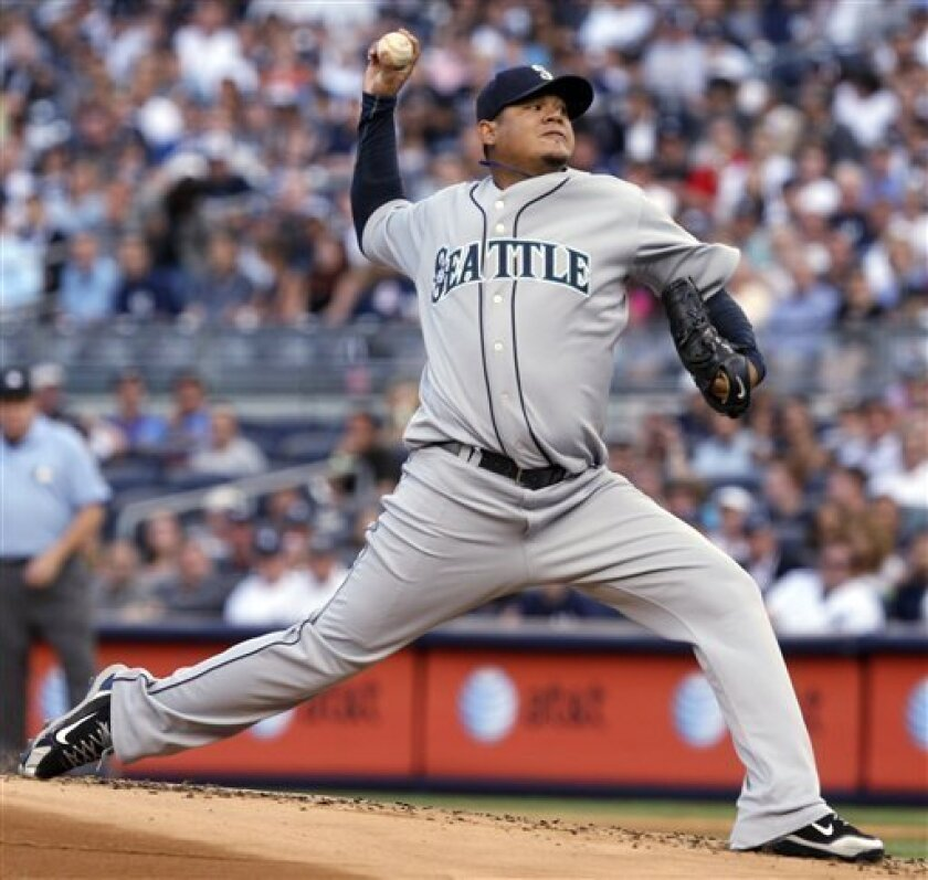 Seattle Mariners' Felix Hernandez pitches during the first inning of a baseball game against the New York Yankees Wednesday, June 30, 2010, at Yankee Stadium in New York. (AP Photo/Seth Wenig)