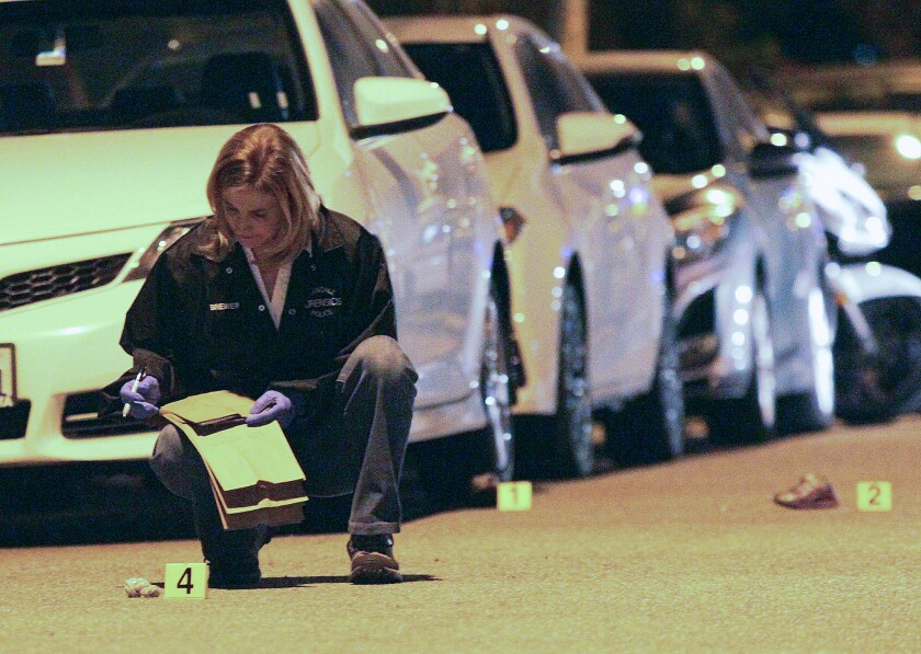 A Glendale Police Department forensics officer documents evidence at the scene where 4-year-old Violeta Khachatoorians was killed by a hit-and-run driver on March 6, 2015.