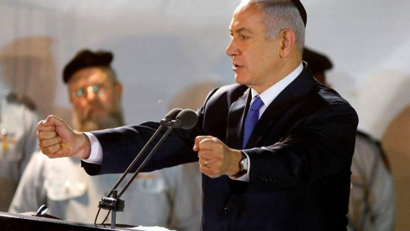 Prime Minister Benjamin Netanyahu attends the funeral of Israeli soldier Zachary Baumel on April 4 in Jerusalem. Baumel went missing in 1982, and his remains were recently repatriated.