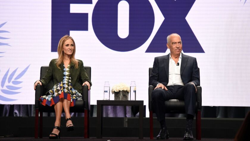 Dana Walden and Gary Newman, co-chairmen of the Fox Television Group, address reporters during their executive session at the Fox portion of Television Critics Assn. at the Beverly Hilton Hotel on Aug. 2.