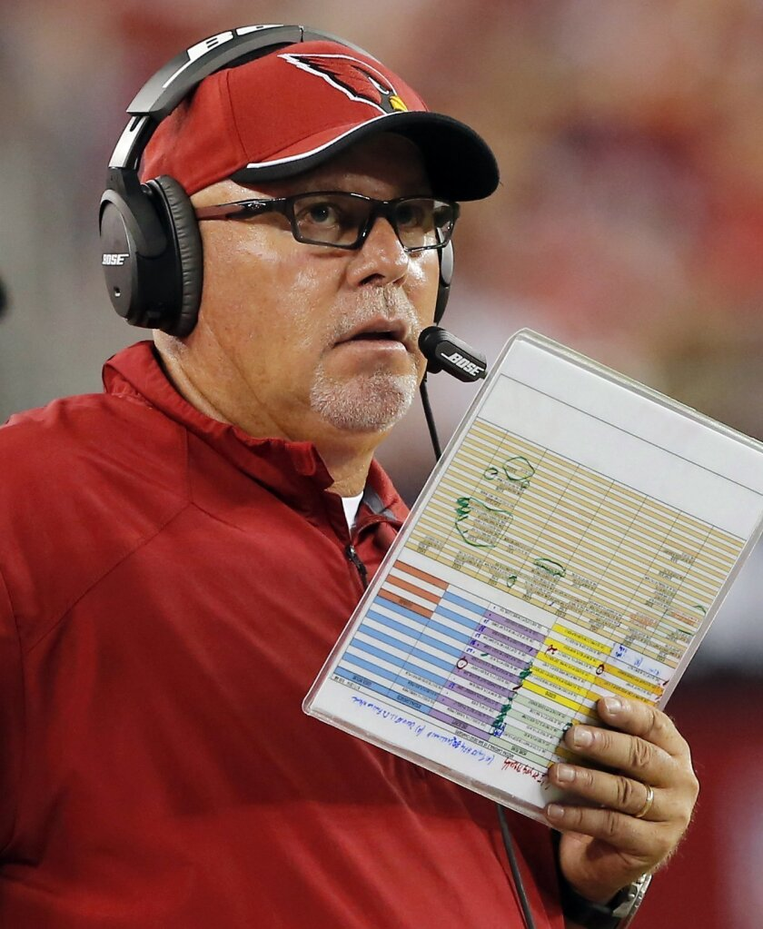 Arizona Cardinals head coach Bruce Arians calls a play during the second half of an NFL football game against the San Diego Chargers, Monday, Sept. 8, 2014, in Glendale, Ariz. (AP Photo/Rick Scuteri)