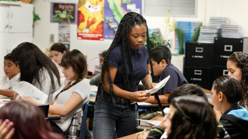 Sherrie Thomas, 13, passes out papers in her eighth-grade pre-Advanced Placement science class at Lennox Middle School on August 22, 2013. California's students performed below average on a national science test in 2015, according to results released late Tuesday.