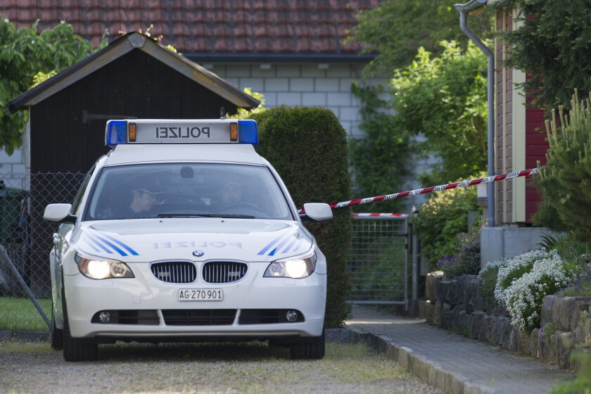 A Swiss police car at the scene of the fatal shootings in Wuerenlingen.