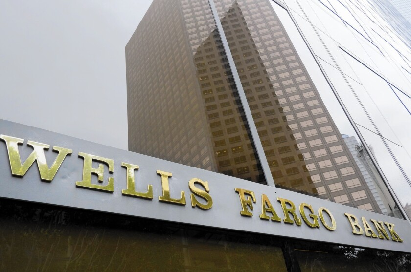 Wells Fargo plans to acquire $32 billion in loans and leases from GE's GE Capital unit.