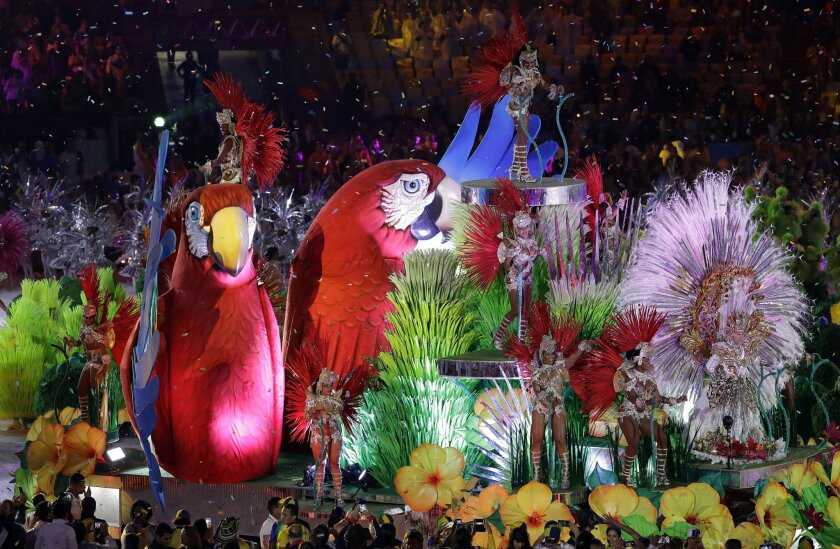 Samba dancers perform during the closing ceremony in the Maracana stadium at the 2016 Summer Olympics in Rio de Janeiro, Brazil, Sunday, Aug. 21, 2016. (AP Photo/Natacha Pisarenko)