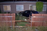 Driver flies off freeway offramp, through fence and into backyard