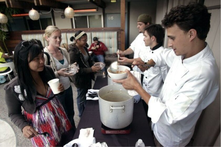 Executive chef Spencer Matthew Johnston (right) served a bowl of soup to Carolyn Candido (left) at The Pearl Hotel.
