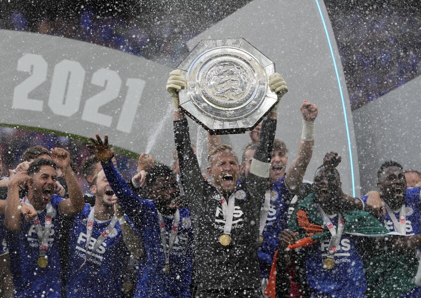 Leicester's goalkeeper Kasper Schmeichel lifts the trophy after winning the English FA Community Shield soccer match between Leicester City and Manchester City at Wembley stadium, in London, Saturday, Aug. 7, 2021. Leicester won the game 1-0.(AP Photo/Alastair Grant)