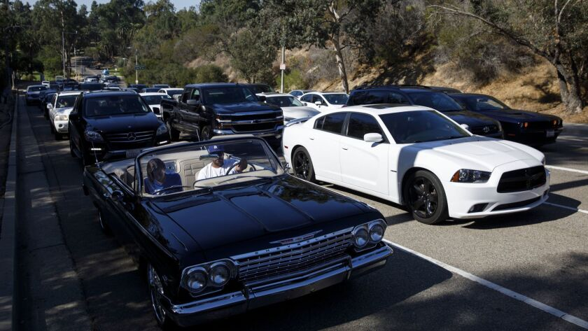 Dodgers fans wait for Dodger Stadium parking to open at the Golden State Gate C in Elysian Park befo