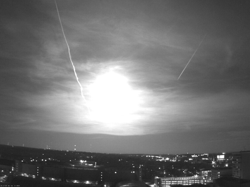 Earth is regularly bombarded by objects from space, such as this April 15, 2010, meteor over Madison, Wis. Researchers say they have shown that the energy from these impacts could have jump-started life on Earth.