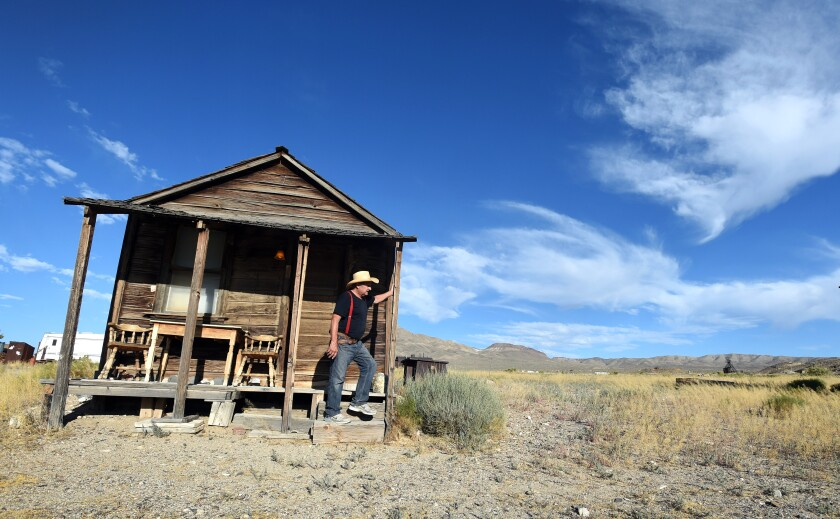 Proprietor Walt Kremin stands among his historic buildings in Gold Point, Nev.
