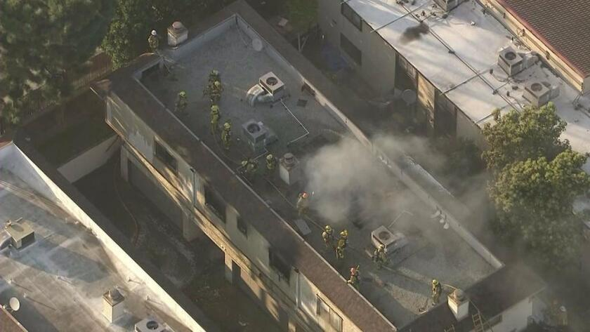 Smoke rises from a Rosemead apartment complex after it caught fire Feb. 17.